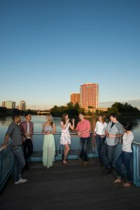 group of friends relaxing on dock near apartment in wilmington de